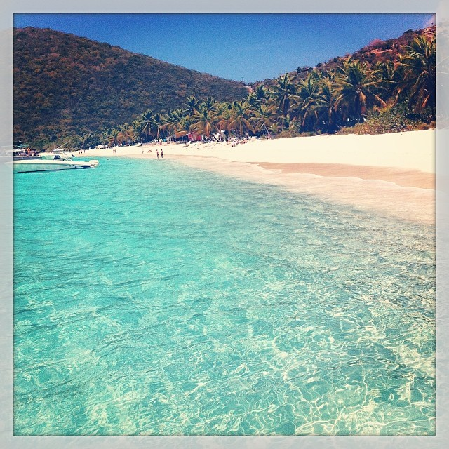 Water Like Crystal. White Bay, Jost Van Dyke, BVI. Is one of the most beautiful places you can visit in the Virgin Islands. Blue waters touching a soft sandy beach lined with coconut palm trees. Pretty nice. Also happens to be the home of the Soggy Dollar.